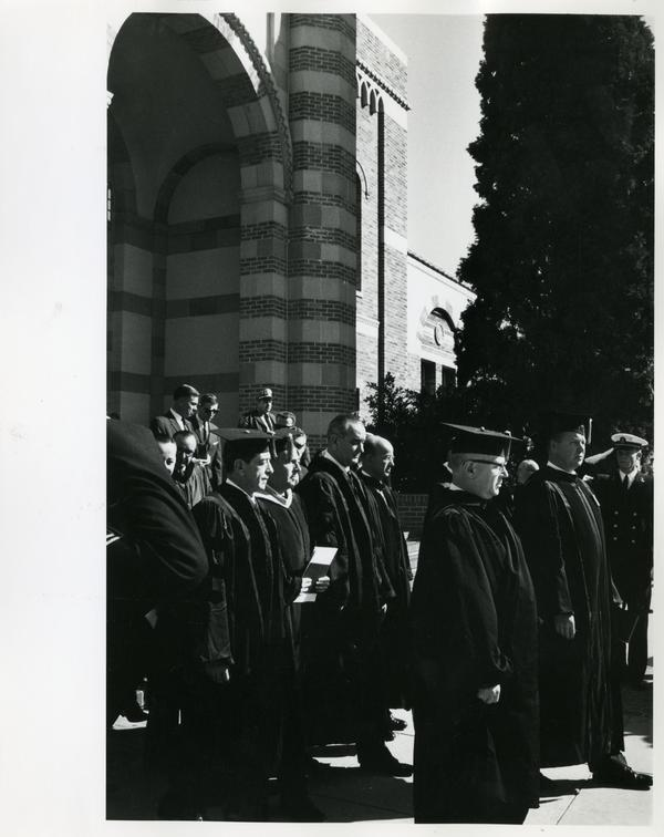 President Johnson walking with others on Charter Day 1964