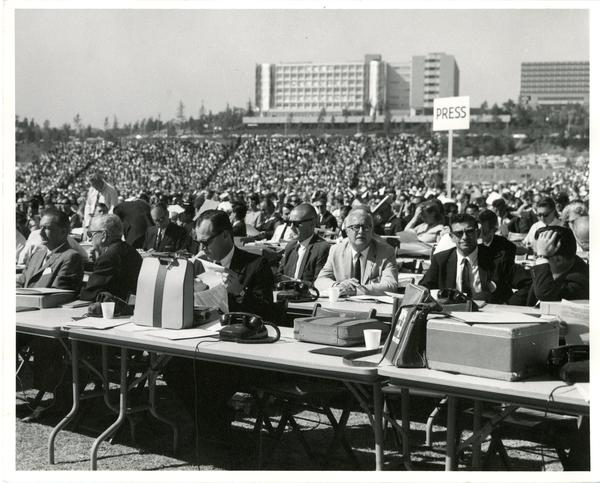View of press section in temporary stadium on Charter Day 1964