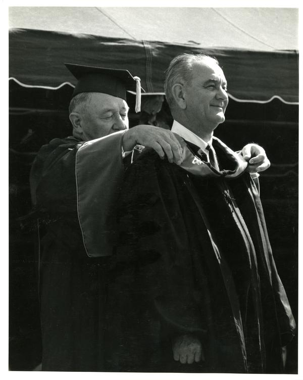 President Lyndon Johnson being hooded by Regent Edwin Pauley on Charter Day 1964