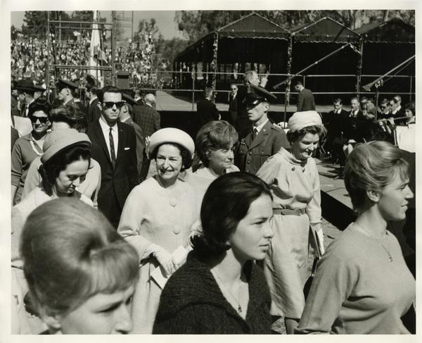 Lady Bird Johnson walking among a crowd of women on Charter Day 1964