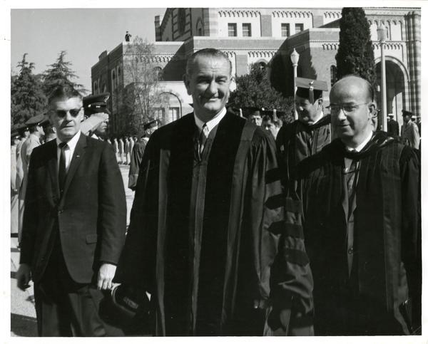 President Lyndon B. Johnson walks next to U.C. President Clark Kerr on Charter Day, 1964
