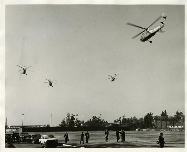Helicopters flying over UCLA campus February 21, 1964