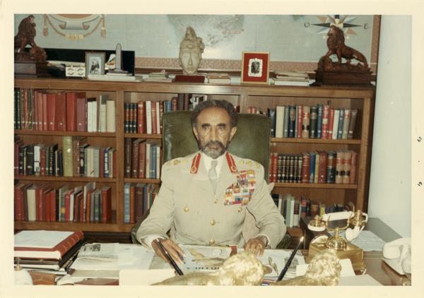 Emperor Haile Selassie of Ethiopia sitting at a desk, 1967