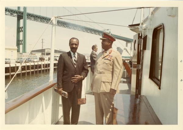 Two unidentified men aboard Motor Yacht Argo, 1967
