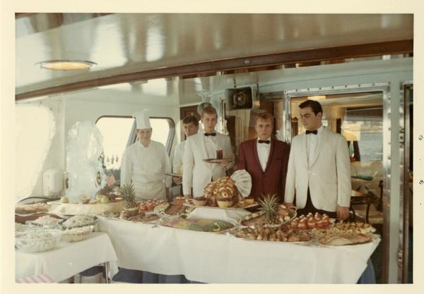 Yacht staff with food prepared for Emperor Haile Selassie's visit, 1967