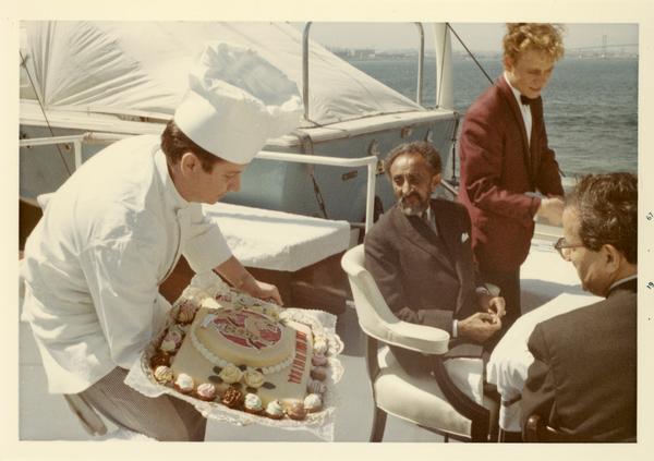 Chef presenting cake to Emperor Haile Selassie of Ethiopia, 1967