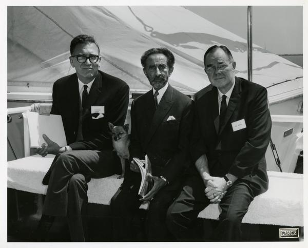 Emperor Haile Selassie of Ethiopia with his dog and two men on Motor Yacht Argo, April 25, 1967