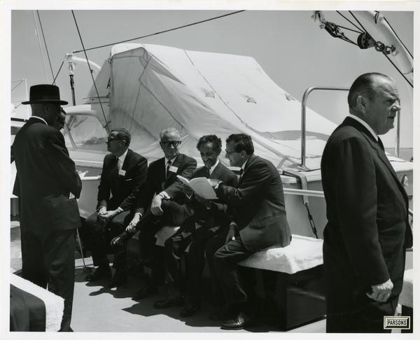 Emperor Haile Selassie looking over documents aboard Motor Yacht Argo, April 25, 1967