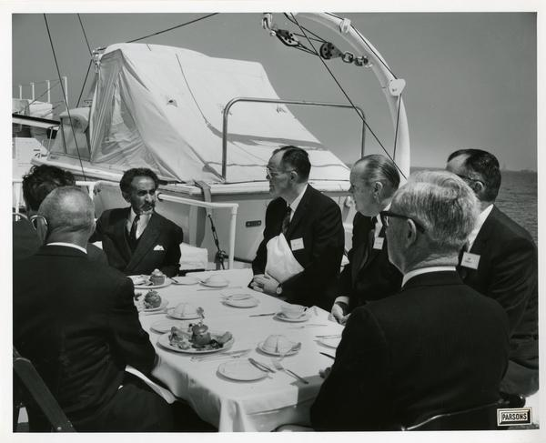 Emperor Haile Selassie eating at the table upon the Motor Yacht Argo, April 25, 1967