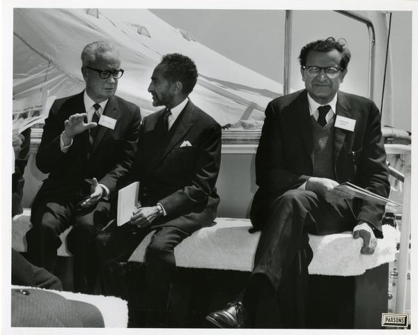 Emperor Haile Selassie talking with unidentified men aboard Motor Yacht Argo, April 25, 1967