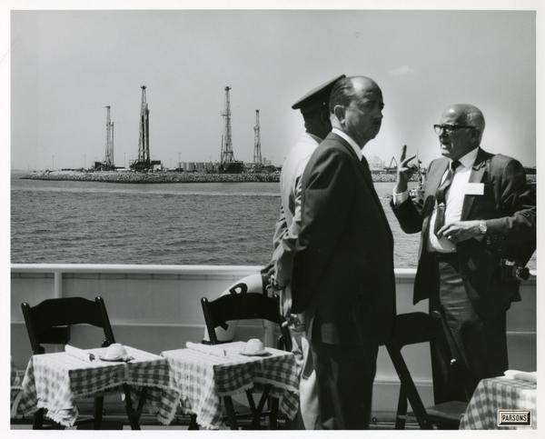 Men talking aboard the Motor Yacht Argo, April 25, 1967
