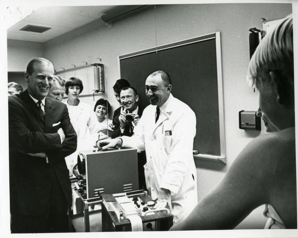 Prince Philip laughing with researchers