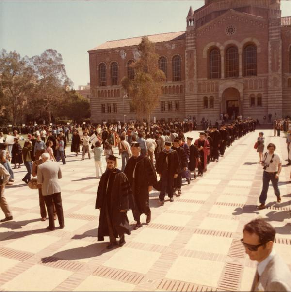 Academic procession in front of Powell Library on Charter Day, April 3, 1975
