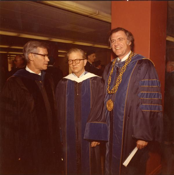 David Saxon, President Hitch, and Chancellor Charles Young pose for a picture on Charter Day, April 3, 1975