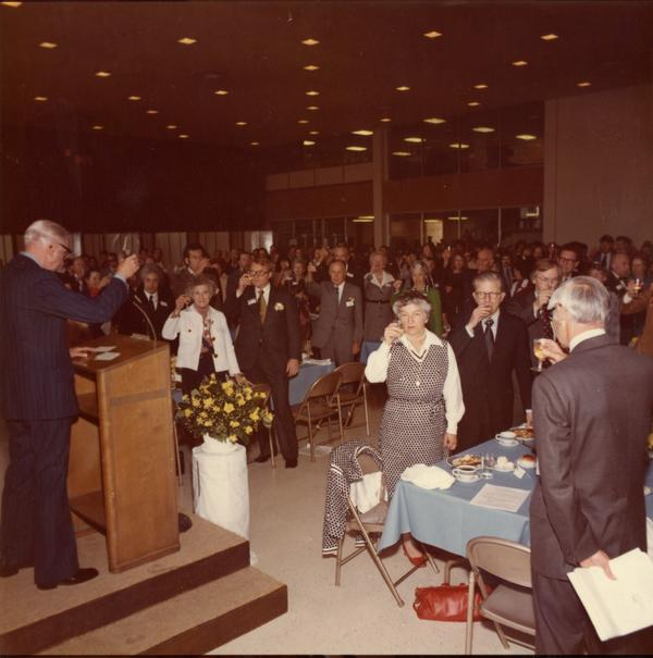 Mrs Donald McLaughlin, President Hitch, Alexei Maradudin, William French Smith, and Robert Conaday at the podium participate in luncheon toast for Charter Day