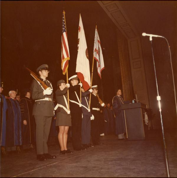 Color guard presenting arms in Royce Hall auditorium on Charter Day, 1975