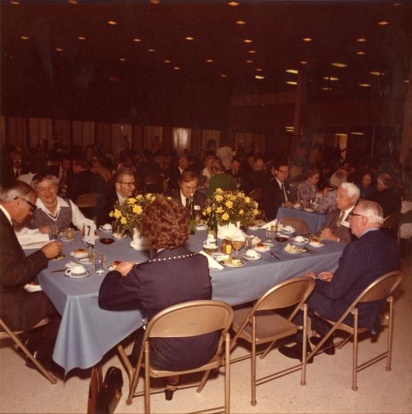 William French Smith, Mrs Donald McLaughlin, President Hitch, Alexei Maradudin, Professor Emeritus Donald McLaughlin and Regent Conaday at luncheon in the Grand Ballroom of Ackerman Union on Charter Day, April 3, 1975