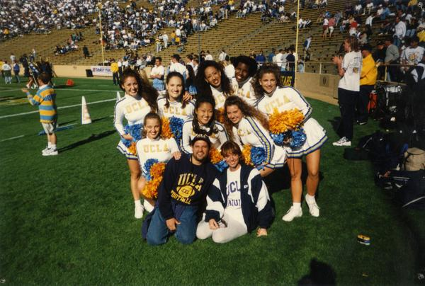 Cheerleaders gathered on field for a game