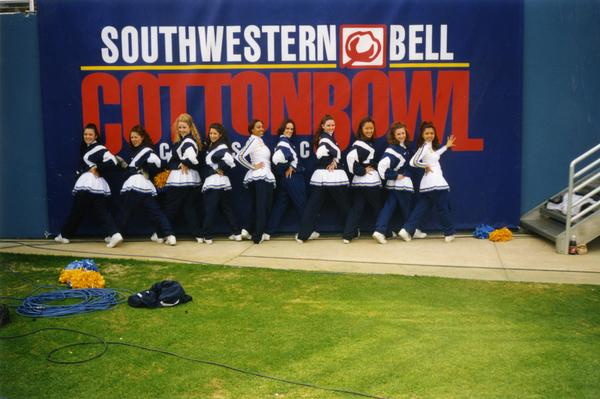 Cheerleaders pose at the Southwestern Bell Cottonbowl