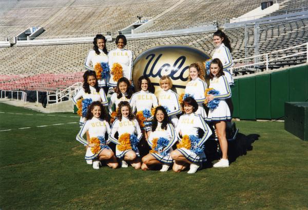 Cheerleader posing on football field