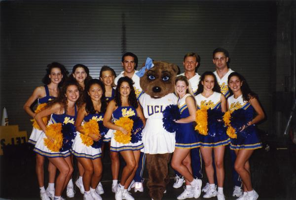 UCLA cheerleaders pose with UCLA mascot, 1997