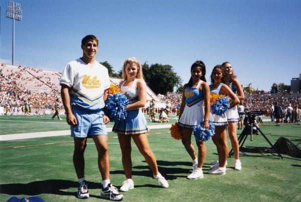 UCLA cheerleaders on the sidelines of football game