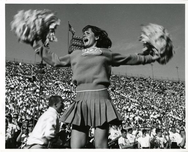 UCLA cheerleader yelling at the crowd at the football game, ca. 1965