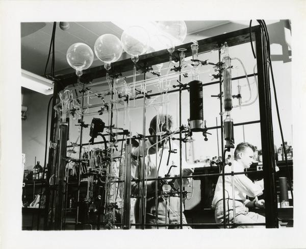 Unidentified men at work in Chemistry lab