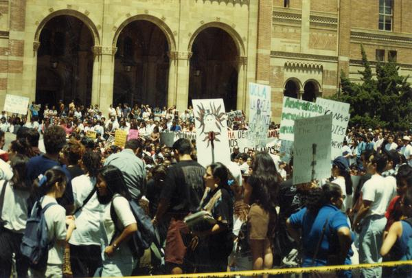 View of Chicano/a student rally attendees gathered in front of Royce Hall, 1993