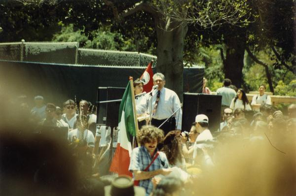 Speaker addresses the crowd at Chicano/a student rally, 1993