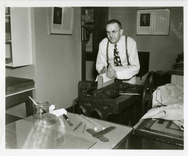 Employee of the William Andrews Clark Library demonstrating eqipment