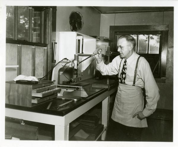 Employee working with equipment in the work room of the William Andrews Clark Library