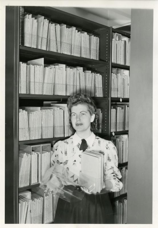 Mrs. Edna C. Davis in the stacks of the William Andrews Clark Library