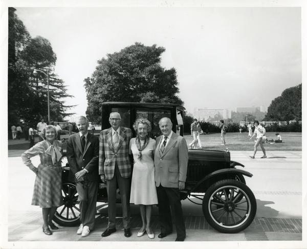 Zada Folz Evans, Jack Smith, John Canaday, Gladys Galbraith and John Jackson, members of the fifty year reunion committee in front of a 1921 Model T Ford