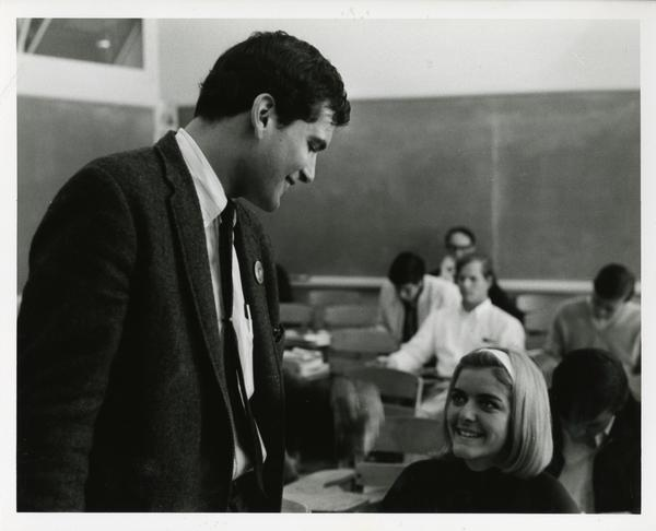 Instructor talking with student, circa 1965