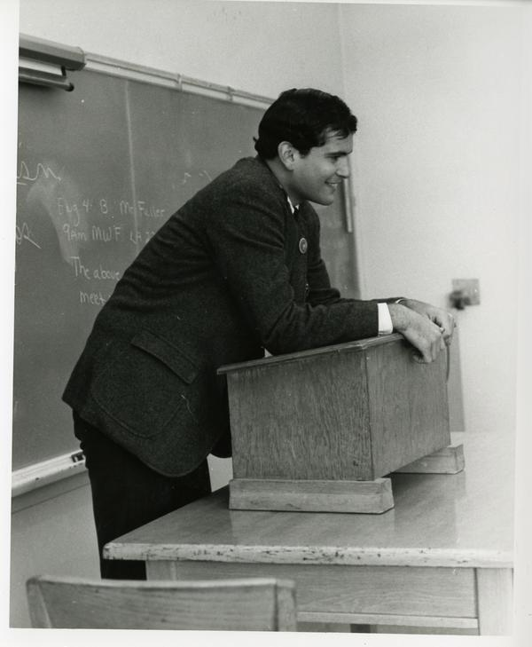 Instructor at a podium in front of the class, circa 1965