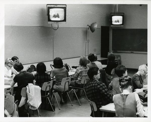 Students watching television in classroom, circa 1965