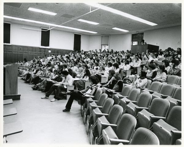 Side view of students in a lecture hall, circa 1985