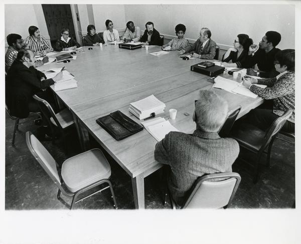 Students and faculty participating in doctoral seminar, circa 1980s