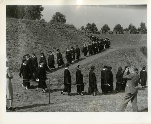 Students filing in for Commencement, circa 1940's