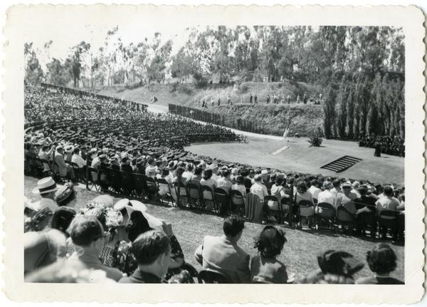 View of audience looking towards stage at Commencement, circa 1940's