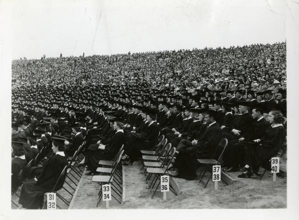 Graduates sitting in the audience at Commencement, circa 1940's