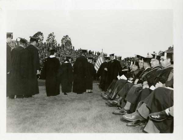 Graduates filing in towards the stage at Commencement, circa 1940's