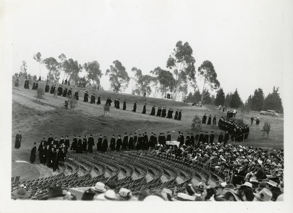 Graduates filing in for Commencement, circa 1940's