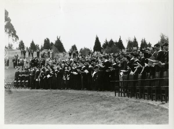 Graduates standing at Commencement, circa 1940's