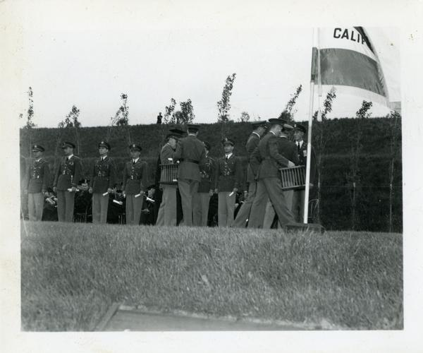Members of the military filing on stage for Commencement, circa 1940's