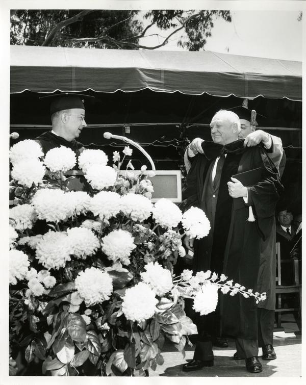 Honoree being hooded at Commencement, 1964