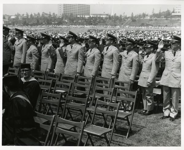 ROTC members standing at Commencement, 1964