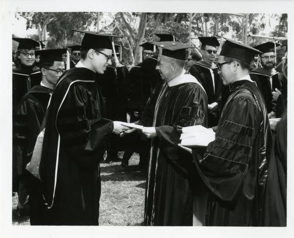 Student receiving his diploma at Commencement, 1964