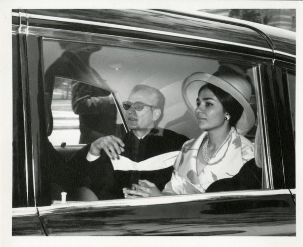 Mohammad Reza Pahlavi, the Shah of Iran, sitting in the car next to a woman at Commencement, 1964